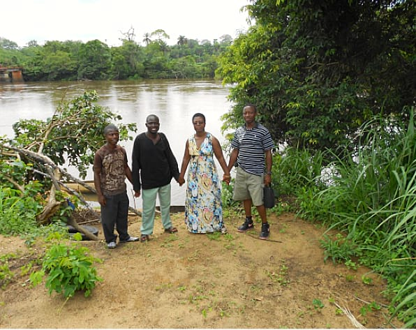 four people smiling