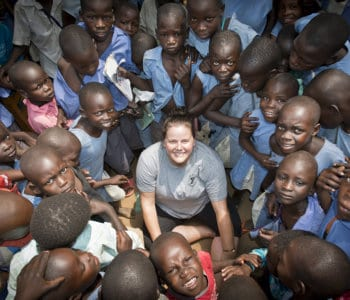 white woman meets a group of friendly African children